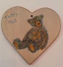 Bear painted on a wooden heart